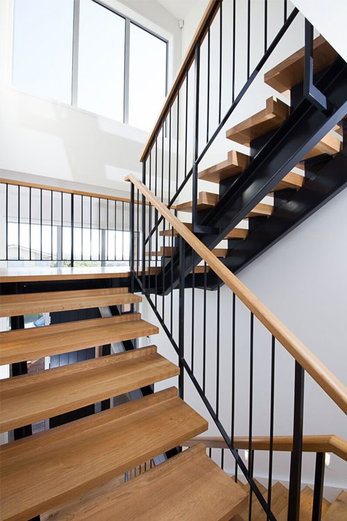 floating stairs with steel rails