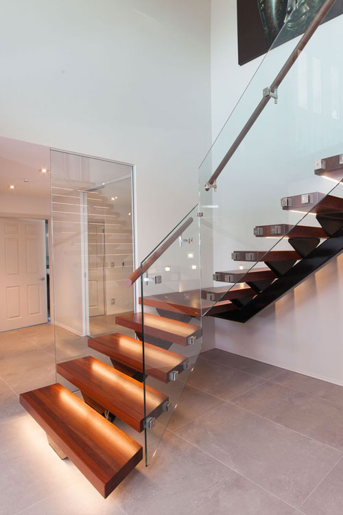 stairs with steel and glass rails